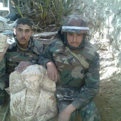 Syrian soldiers with scuplture